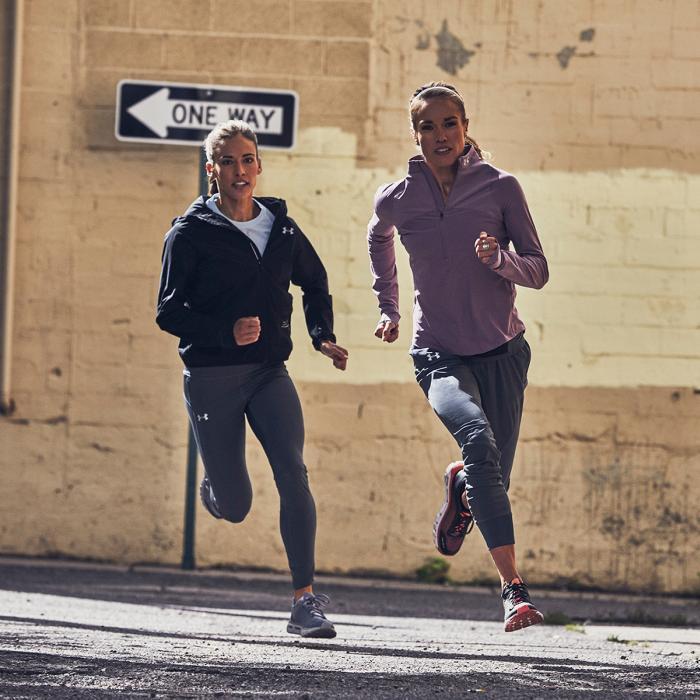 women running in Under Armour training gear