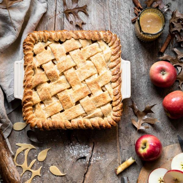 Flatlay of an apple pie in a Le Creuset dish