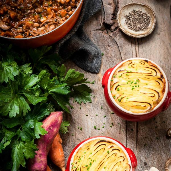 Flatlay of a veggie shepherd's pie in a Le Creuset pot